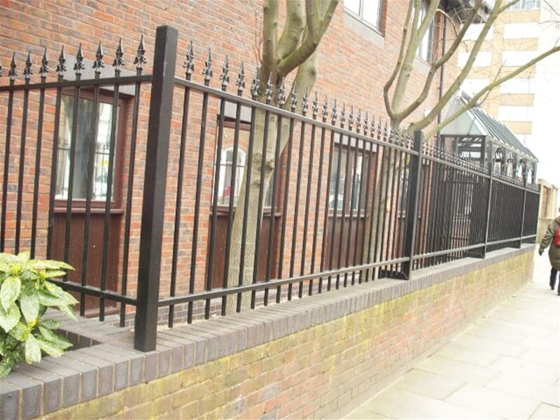 Ornamental fencing cranked on to wall