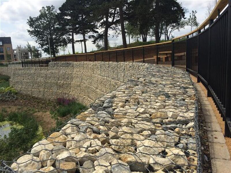 Penshurst railings curved around gabion wall