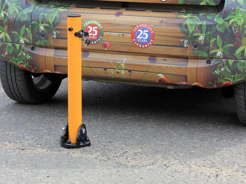 Collapsible steel parking post