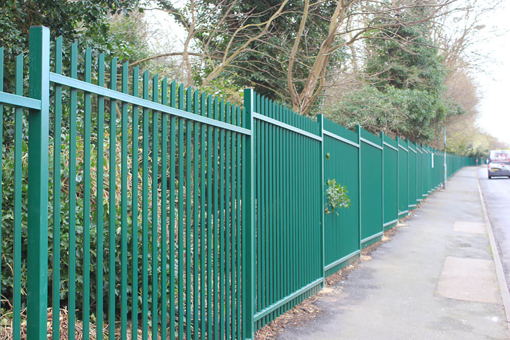 Green commercial vertical bar fencing