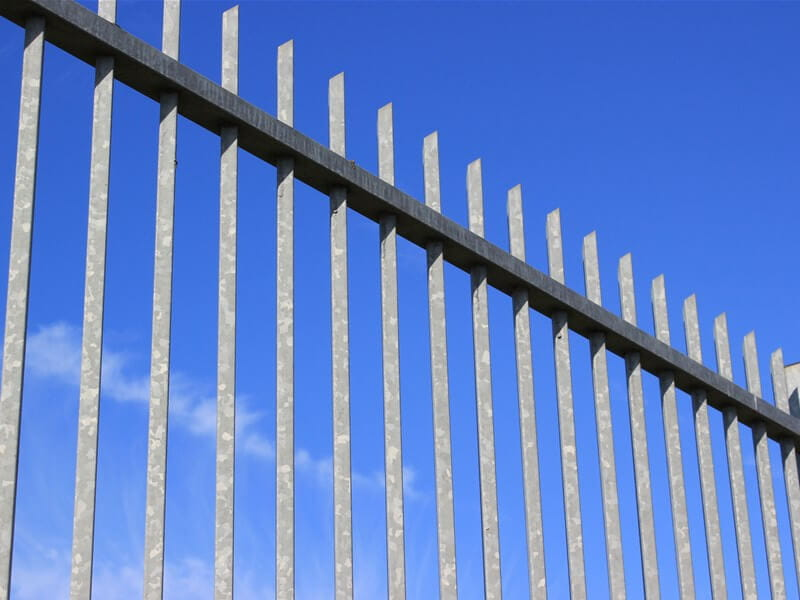 Galvanised metal vertical bar fencing