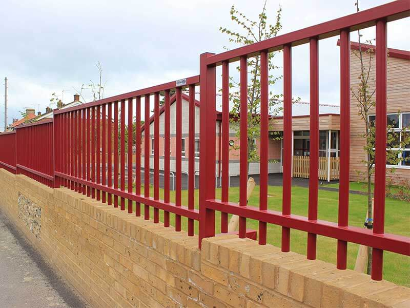 Sentry Fencing on top of wall maroon powder coated finish