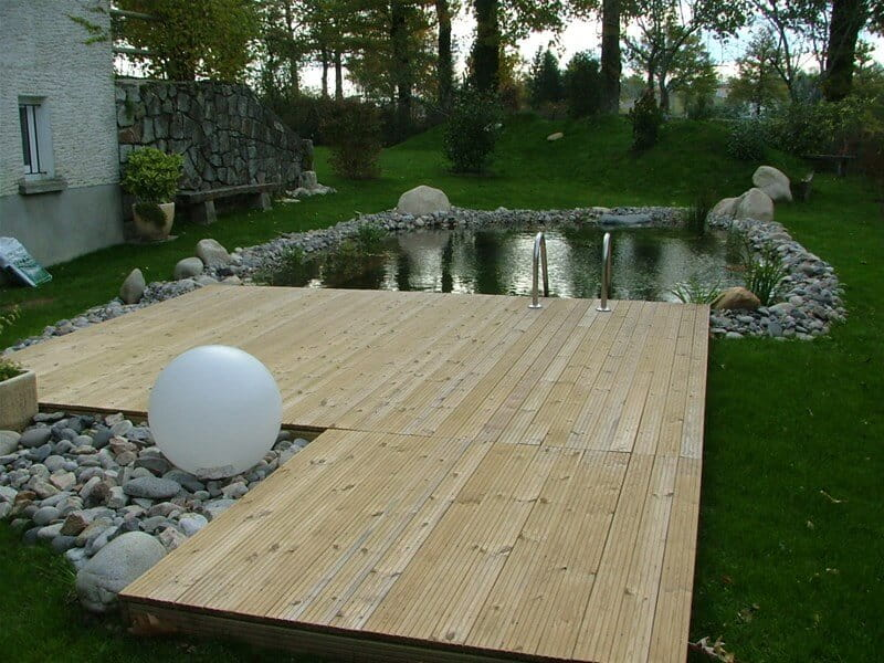 Swimming pool with timber decking
