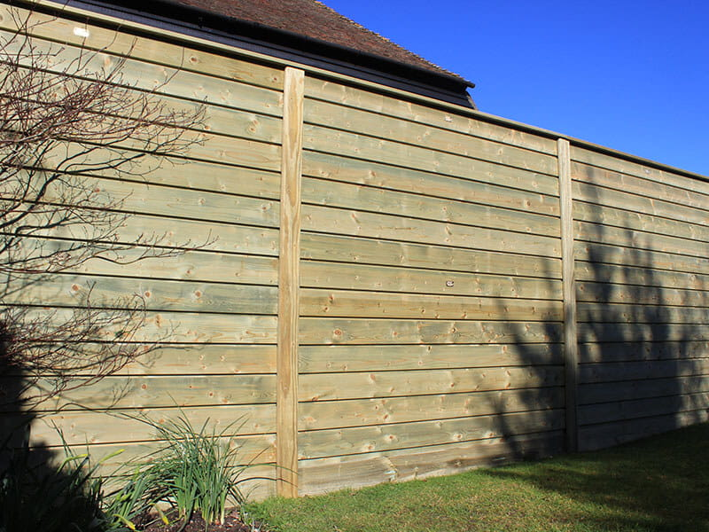 Timber cladding fence